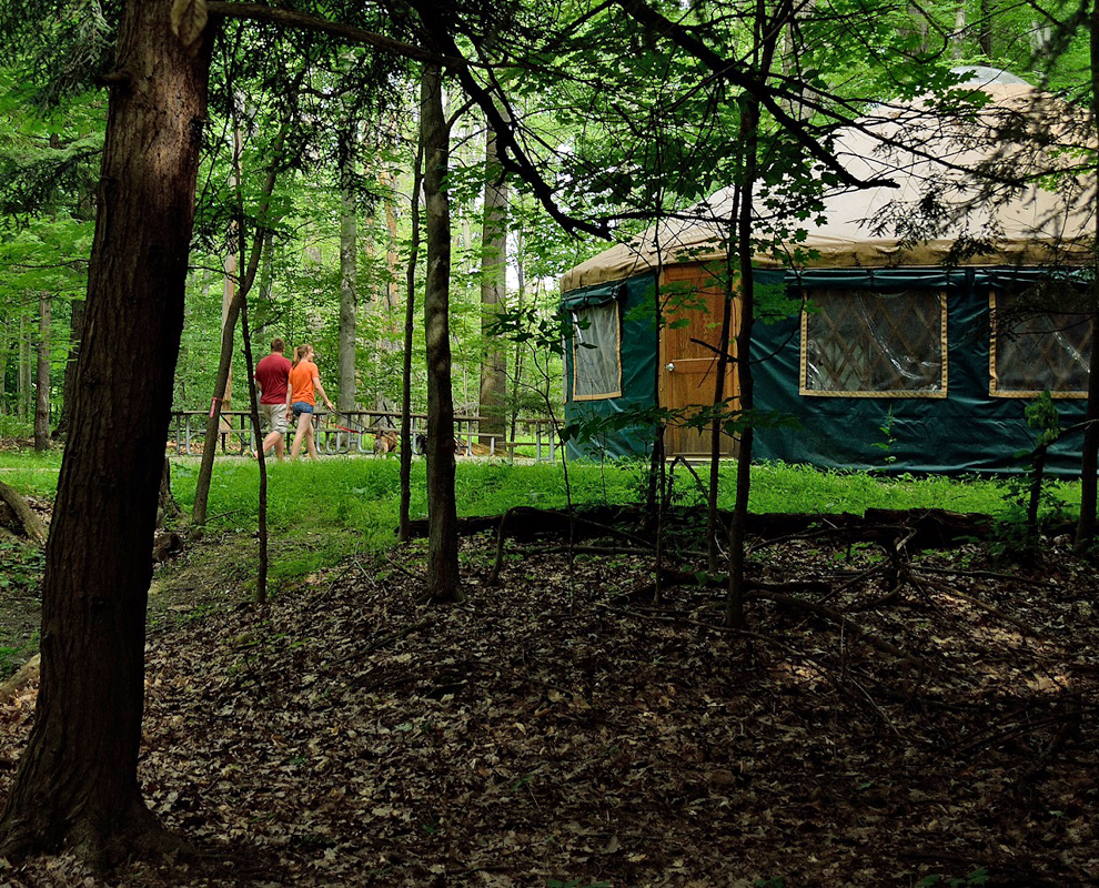 Environmental Learning Center - park - trees - trail - couple walking dog - yurt - Lake Metroparks - photo by Jim Marquardt